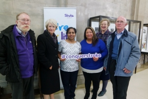 Photograph of Nancy Rothwell with stroke survivors at the exhibition